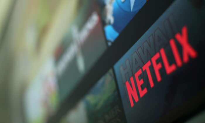 The Netflix logo is pictured on a television in this illustration photograph taken in Encinitas, California, on Jan. 18, 2017. (Mike Blake/Reuters, File Photo)