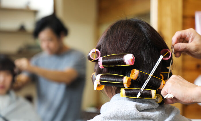Going to a cosmetology school rather than a salon can save you money.  (metamorworks/Shutterstock)