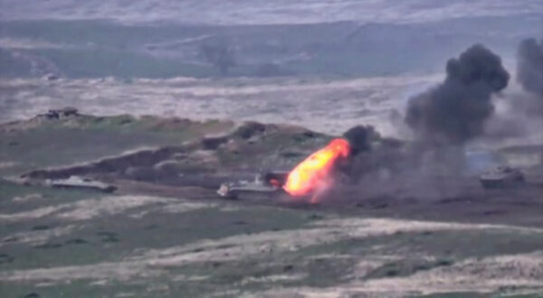 A still image shows what is said to be a destroyed Azerbaijani armoured vehicle in Nagorno-Karabakh