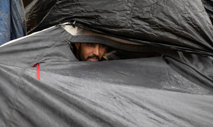 A migrant sits in his tent at One Stop Center for Migrants, near the border with Hungary in Subotica, Serbia, on Sept. 25, 2020. (Marko Djurica/Reuters)