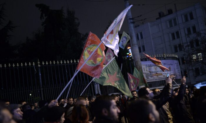 Kurds wave the flags of the Kurdistan Workers' Party to celebrate, hours after Kurdish fighters backed by intense U.S.-led airstrikes pushed the ISIS terrorist group entirely out of a key Syrian town, in Istanbul, Turkey, on Jan. 26, 2015. (The Associated Press)