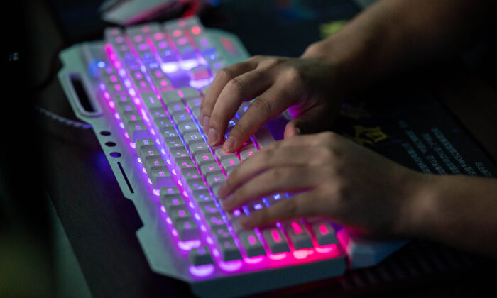 A member of a hacking group uses his computer at their office in Dongguan, Guangdong province, China, on Aug. 4, 2020. (Nicolas Asfouri/AFP via Getty Images)