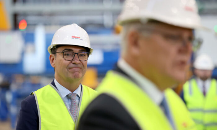 South Australian Premier Steven Marshall stands behind Australian Prime Minister Scott Morrison speaks to the media during a visit to the Osborne Naval Shipyard  on September 26, 2020 in Adelaide, Australia. (Kelly Barnes/Getty Images)