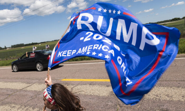 Trump supporters wave flags outside of Mankato Regional Airport as President Donald Trump makes a campaign stop in Mankato, Minn., on Aug. 17, 2020. (Stephen Maturen/Getty Images)