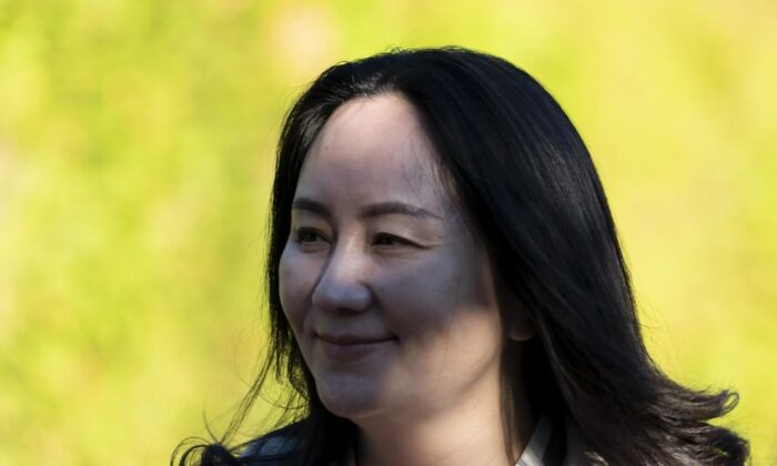 Meng Wanzhou leaves her home to head to Supreme Court in Vancouver on Sept. 28, 2020.  (Jonathan Hayward/The Canadian Press)
