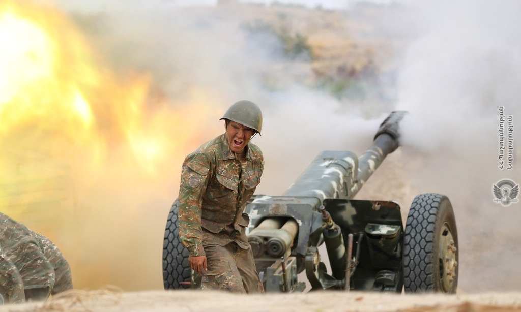 An ethnic Armenian soldier fires an artillery piece 2