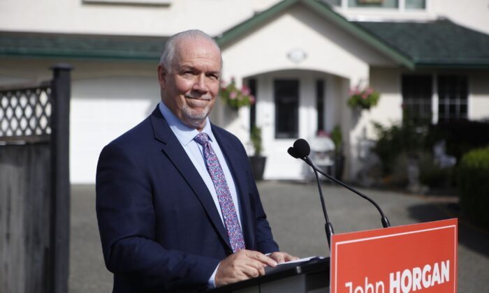 Premier John Horgan announces a fall election at a press conference in Langford, B.C., on Sept. 21, 2020. (The Canadian Press/Chad Hipolito)