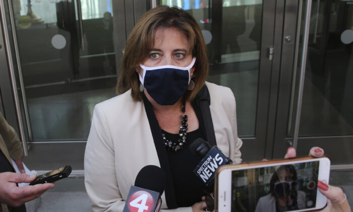 Federal defender Fonda Kubiak addresses the media following Pascale Ferrier's court appearance in Buffalo, N.Y., on Sept. 22, 2020. (AP Photo/Jeffrey T. Barnes)