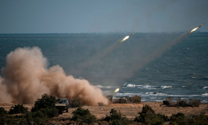 """China, Russia, Iran, Pakistan and Myanmar troops launch rockets from missile systems during the """"Caucasus-2020"""" military drills at the Turali range on the Caspian Sea coast in the Republic of Dagestan in Southern Russia on September 23, 2020. (DIMITAR DILKOFF/AFP via Getty Images)"""