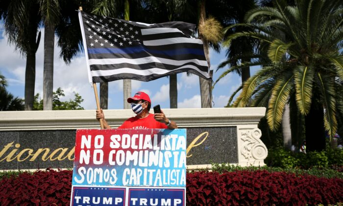 """Supporters of US President Donald Trump rally outside the """"Latinos for Trump Roundtable"""" event at Trump National Doral Miami golf resort in Doral, Florida, on Sept. 25, 2020. (Marco Bello/AFP via Getty Images)"""