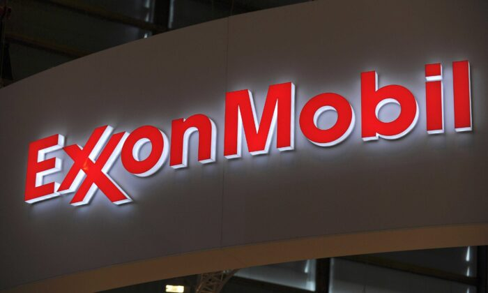 A picture shows the logo of U.S. oil and gas giant ExxonMobil during the World Gas Conference exhibition in Paris on June 2, 2015. (Eric Piermont/AFP via Getty Images)