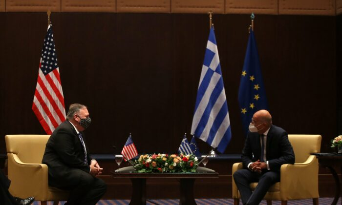 Secretary of State Mike Pompeo (L) and Greek Foreign Minister Nikos Dendias speak during their meeting in the northern city of Thessaloniki, Greece, on Sept. 28, 2020. (Giannis Papanikos/AP Photo)