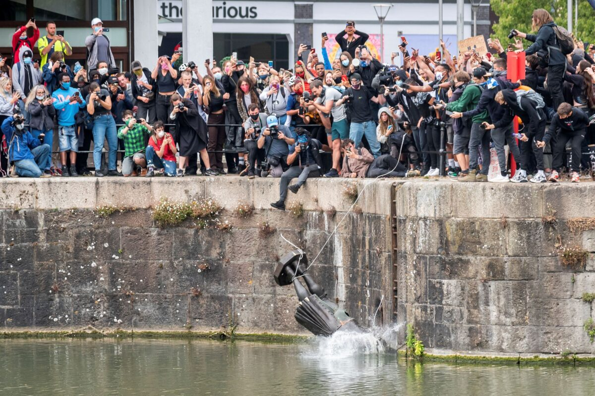 17th century merchant, Edward Colston, as it falls into the water during a Black Lives Matter protest in Bristol, England
