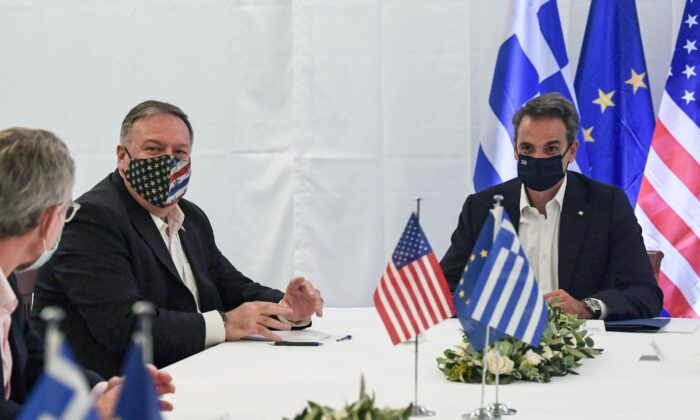 U.S. Secretary of State Mike Pompeo and Greek Prime Minister Kyriakos Mitsotakis hold a meeting during their visit to the Naval Support Activity base at Souda, Crete, Greece, on Sept. 29, 2020. (Aris Messinis/Pool via Reuters)