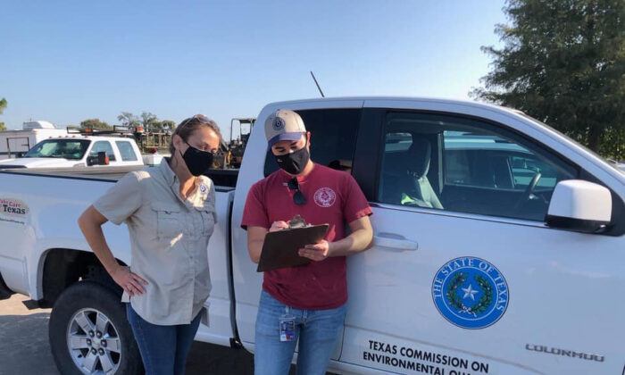 Investigators from the Texas Commission on Environmental Quality are present on a scene in Lake Jackson to conduct water sampling after a brain-eating amoeba was detected in the water supply in Lake Jackson, Texas, on Sept. 26, 2020. (Texas Commission on Environmental Quality/Handout via Reuters)
