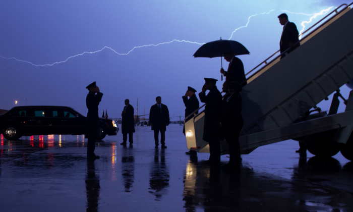 President Donald Trump disembarks from Air Force One as lightning splits the sky during a storm at Joint Base Andrews, Md., on Aug. 28, 2020. (SAUL LOEB/AFP via Getty Images)