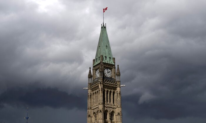 Storm clouds over the Peace Tower and Parliament Hill in Ottawa on Aug. 18, 2020. THE CANADIAN PRESS/Adrian Wyld