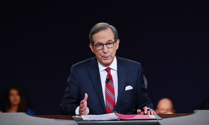 Debate moderator and Fox News anchor Chris Wallace moderates the first presidential debate between President Donald Trump and Democratic presidential nominee Joe Biden at the Health Education Campus of Case Western Reserve University in Cleveland, Ohio, on Sept. 29, 2020. (Olivier Douliery/Pool/Getty Images)