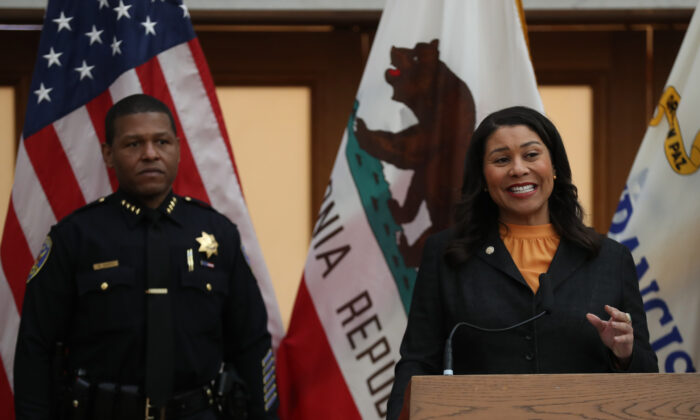 San Francisco Mayor London Breed (R) speaks during a press conference at San Francisco City Hall on March 16, 2020. (Justin Sullivan/Getty Images)