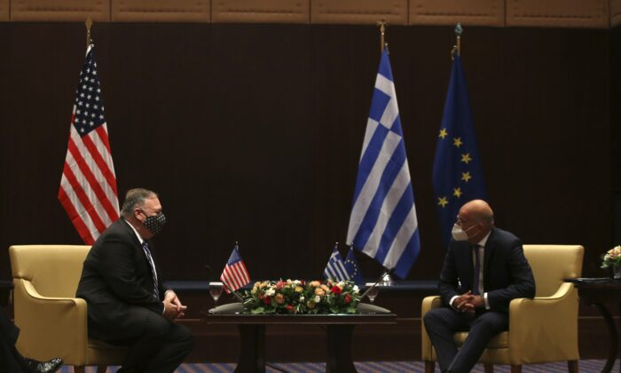 U.S. Secretary of State Mike Pompeo (L) and Greek Foreign Minister Nikos Dendias speak during their meeting in the northern city of Thessaloniki, Greece, on Sept. 28, 2020.  (AP Photo/Giannis Papanikos, Pool)