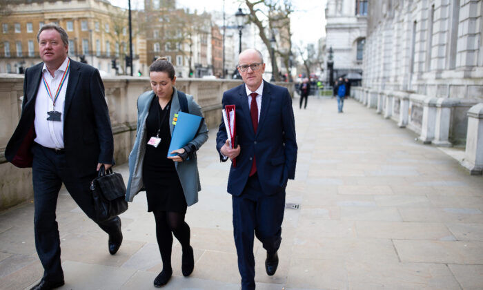Minister of State for School Standards Nick Gibb (R) arrives at the Cabinet Office ahead of a government COVID-19 Cobra meeting in London on March 11, 2020. (Luke Dray/Getty Images)