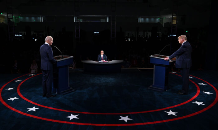 President Donald Trump, right, and Democratic presidential nominee Joe Biden take part in the first presidential debate at Case Western Reserve University and Cleveland Clinic in Cleveland, Ohio, on Sept. 29, 2020. (Olivier Douliery/Pool/AFP via Getty Images)