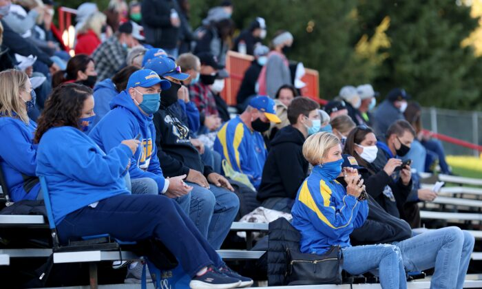 Fans sit in the stands wearing masks during a high school football game in Clinton, Mich., Sept. 18, 2020. (Justin Casterline/Getty Images)