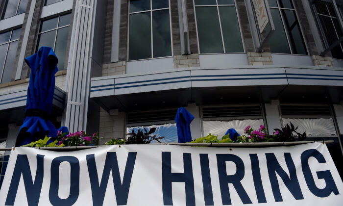 """A restaurant displays a """"Now Hiring"""" sign amid the coronavirus pandemic, in Arlington, Va., on Aug. 4, 2020. (Olivier Douliery /AFP via Getty Images)"""