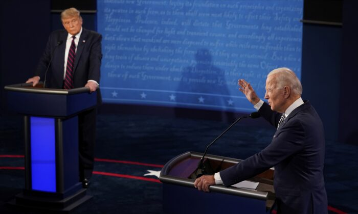 President Donald Trump listens to Democratic presidential candidate former Vice President Joe Biden during the first presidential debate at Case Western Reserve University and Cleveland Clinic in Cleveland, Ohio, on Sept. 29, 2020. (Morry Gash/Pool/AP Photo)