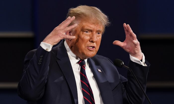 President Donald Trump gestures while speaking during the first presidential debate at Case Western University and Cleveland Clinic, in Cleveland, Ohio, Sept. 29, 2020. (Julio Cortez/AP Photo)