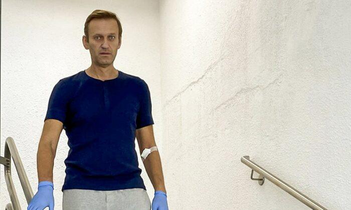 Russian opposition leader Alexei Navalny walks down stairs in a hospital in Berlin, Germany, on Sept. 19, 2020. (Navalny Instagram via AP)