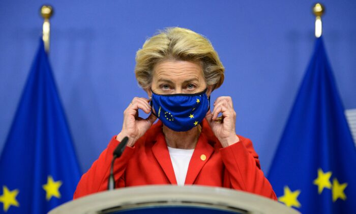 European Commission President Ursula von der Leyen takes off her face mask prior to making a statement regarding the Withdrawal Agreement at EU headquarters in Brussels, on Oct. 1, 2020. (Johanna Geron/Pool via AP)