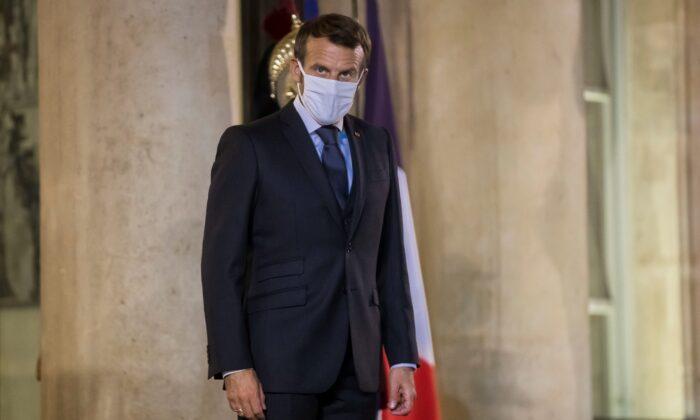 French President Emmanuel Macron stands during a meeting with Kenyan President Uhuru Kenyatta at the Elysee Palace in Paris, on Sept. 30, 2020. (Christophe Petit Tesson/Pool via Reuters)