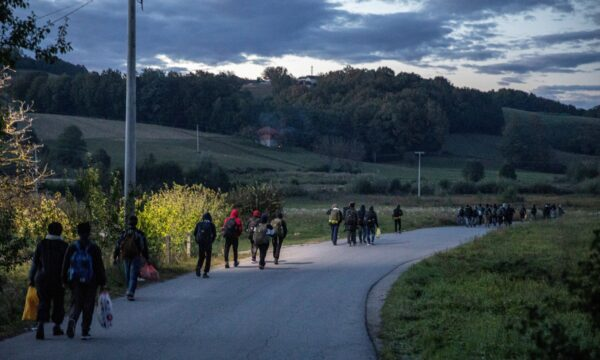 Migrants walk towards the Bosnia-Croatia border