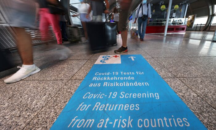 Signs lead the way towards COVID-19 test centers at the airport in Frankfurt, Germany, on Aug. 11, 2020. (Kai Pfaffenbach/Reuters)