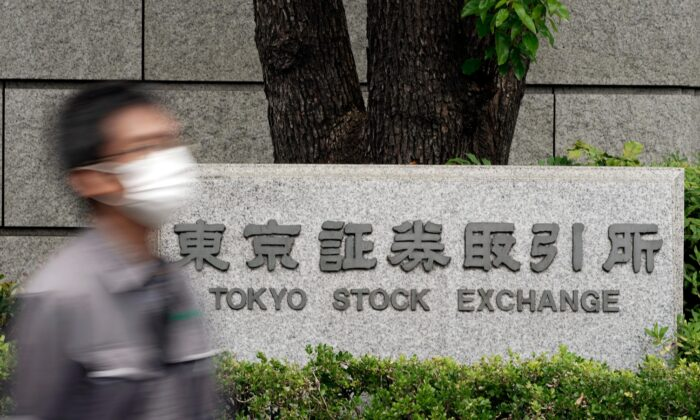 A man walks by the Tokyo Stock Exchange building, in Tokyo, Japan, on Oct. 1, 2020. (Eugene Hoshiko/AP Photo)