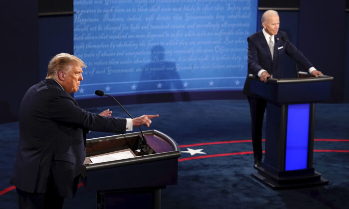 President Donald Trump makes a point as Democratic presidential candidate former Vice President Joe Biden listens during the first presidential debate at Case Western University and Cleveland Clinic, in Cleveland, Ohio, on Sept. 29, 2020. (Morry Gash/Pool/AP Photo)