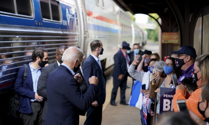 Democratic presidential nominee Joe Biden greets supporters on the platform outside the Amtrak's Greensburg Train Station in Greensburg, Penn., on Sept. 30, 2020. (Andrew Harnik/AP Photo)