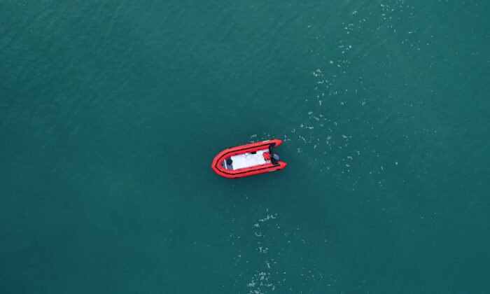 In this aerial image from a drone, an empty migrant dinghy floats off the beach at St Margaret's Bay after the occupants landed from France in Dover, England, on Sept. 11, 2020. (Christopher Furlong/Getty Images)