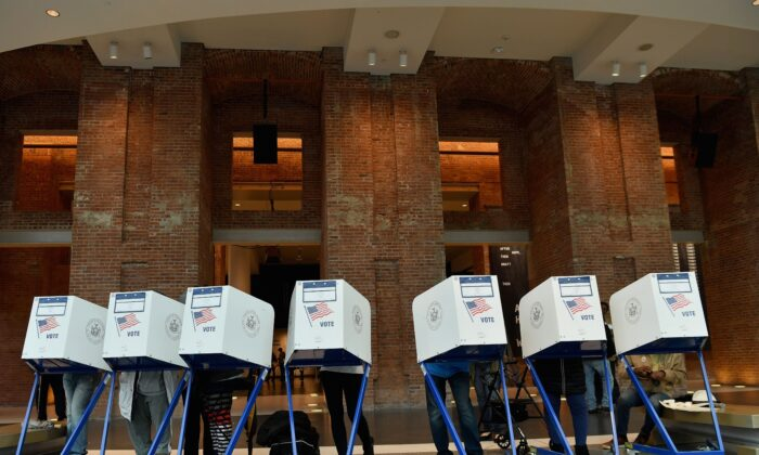 Voters cast their ballot in the midterm election at the Brooklyn Museum polling station in New York on Nov. 6, 2018. (Angela Weiss/AFP via Getty Images)