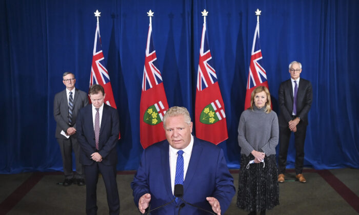 Ontario Premier Doug Ford holds a press conference with his medical team regarding new restrictions at Queen's Park during the COVID-19 pandemic in Toronto on  Oct. 2, 2020. (The Canadian Press/Nathan Denette)