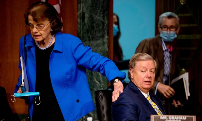 """Chairman Sen. Lindsey Graham (R-S.C.) and Ranking Member Sen. Dianne Feinstein, (D-Calif.), arrive for a Senate Judiciary Committee Hearing """"to examine COVID-19 fraud, focusing on law enforcement's response to those exploiting the pandemic"""" on Capitol Hill in Washington, on June 9, 2020. (Andrew Harnik/Pool/AFP via Getty Images)"""