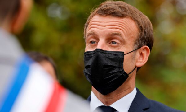 French President Emmanuel Macron wears a protective face mask