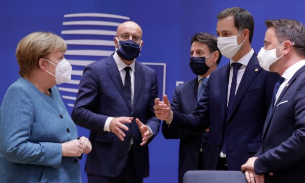 German Chancellor Angela Merkel speaks with the others