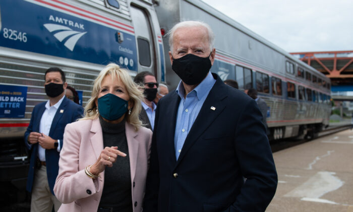Democratic presidential nominee and former Vice President Joe Biden and his wife Jill speak to the press before boarding a train in Cleveland, Ohio, on Sept. 30, 2020. (Roberto Schmidt/AFP via Getty Images)