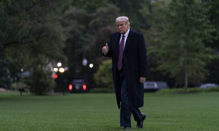 President Donald Trump gives the thumbs-up as he walks from Marine One to the White House in Washington as he returns from Bedminster, N.J., Oct. 1, 2020. (Carolyn Kaster/AP Photo)