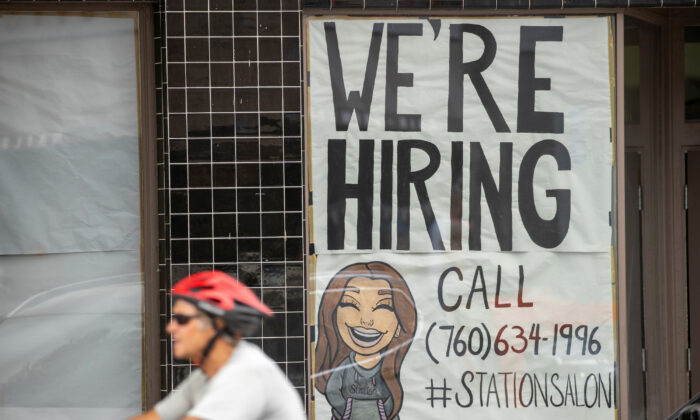 A new business advertises for workers as it prepares to open up in Encinitas, Calif., on July 30, 2020. (Mike Blake/Reuters)