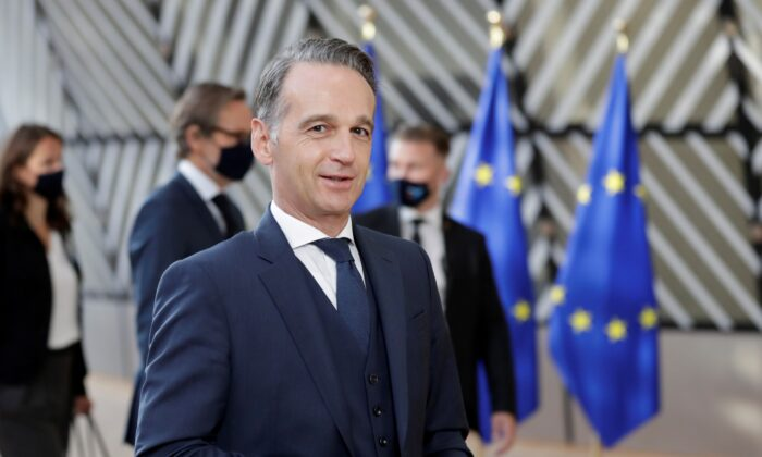 German Minister of Foreign Affairs Heiko Maas walks during the foreign affairs ministers council in Brussels, Belgium, on Sept. 21, 2020. (Olivier Hoslet/Pool via Reuters)