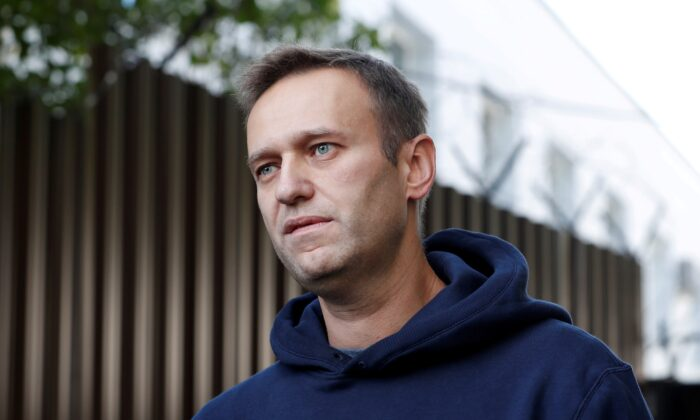 Russian opposition leader Alexei Navalny speaks with journalists after he was released from a detention centre in Moscow, Russia, on Aug. 23, 2019. (Evgenia Novozhenina/Reuters)