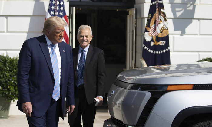 President Donald Trump and White House trade adviser Peter Navarro check out the new Endurance all-electric pickup truck on the south lawn of the White House in Washington on Sept. 28, 2020. (Tasos Katopodis/Getty Images)
